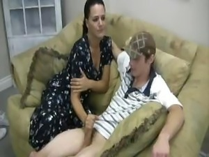 A guy in cap receiving great handjob from a busty brunette