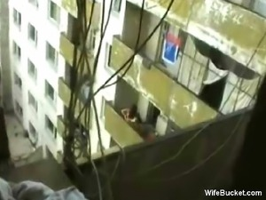 Watching the hot neighbour shagging on balcony