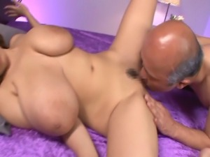 Big tits Hitomi Tanaka wearing a yellow dress having her pussy and huge boobs...