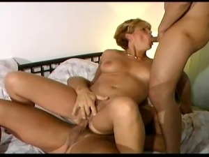 Very hot MILF getting fucked by two big guys. Experienced MILF takes both...