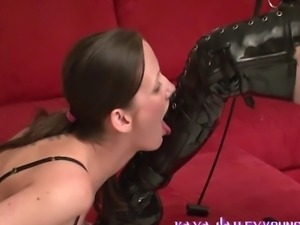 Boot licking by a Lesbian, she is made to kneel and lick the boots of her...