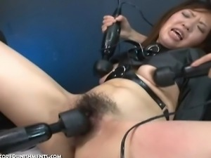 A very pretty Japanese fetish submissive, is bound in a dungeon endures...