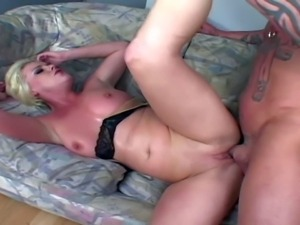Tempting short haired blonde whore with natural tits gives head to randy hunk...