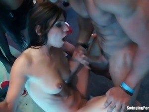 Bisexual club hookers licking their slick pussies and fucking giant pricks in...