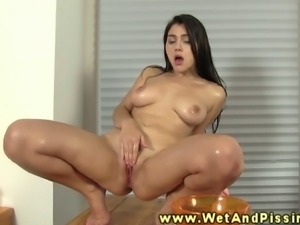 A urine loving brunette is licking her own golden pee