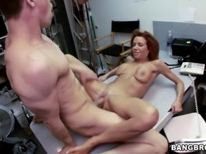 redhead sucks cock in the backroom