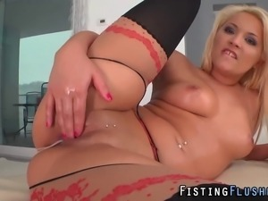 Solo bitch in stockings fists and toys her gaping pussy