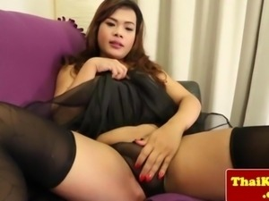 Busty thailand ladyboy plays with dick