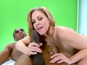 Julia Ann is a blonde milf with huge tits who needs to have interracial sex....