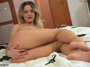 Playful solo girl Eva Kerstin with natural boobs pulls down her black panties...