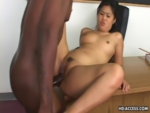 Super hot Asian lady gets a big black cock in her cunt free