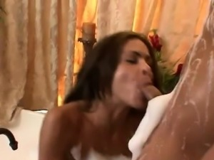 hot brunette with huge tits in a soapy bath