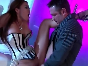 Curvy Asian woman is slipping out of her corset while she is with a guy. Her...