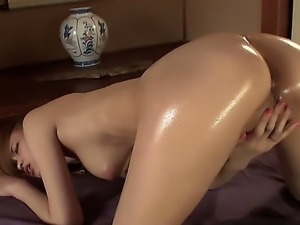 A slutty asian always covers her naked flesh with oil when she takes her...