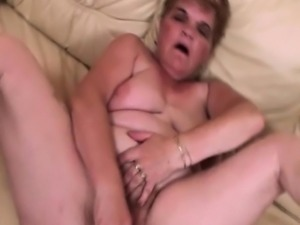 Mature BBW self fucking with a large dildo