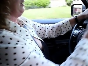 Hot married lady drives around town flashing her marvelous big hooters