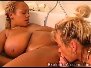 Busty ebony whore in nice lesbian bathroom action