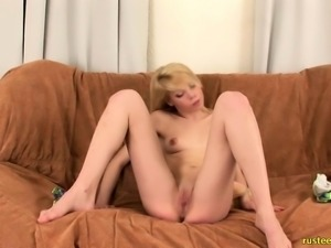 Blonde cutie puts her slim body on display and has fun with a sex toy