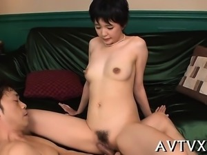 Sweet oriental casts a lusty spell with her skilful oral sex