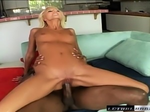 Sexy slim blonde girl brings a fantasy with a black stud to fruition