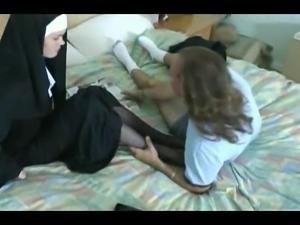 Nun giving a Nylon Footjob