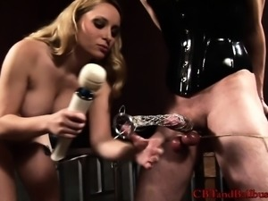 Busty blonde mistress clamps her corseted slave's cock and balls in hardcore...