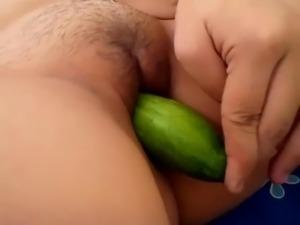Filipina playing cucumber
