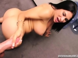 Sexy brunette mom with big boobs puts her handjob talents on display