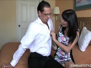 Horny brunette cougar strokes a cock to full hardness with a playful handjob