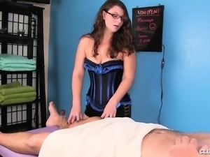 Hung guy has a naughty brunette masseuse working her hands on his dick