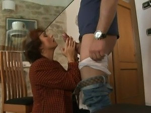 Mature woman pays the repairman.