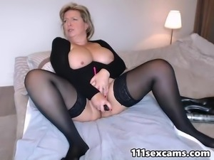 Busty mature masturbating on webcam