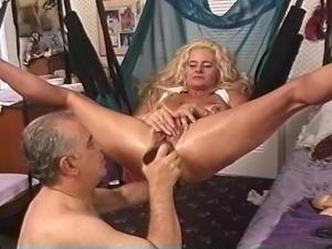 Mature Blonde slut in sling stuffed with huge dildos