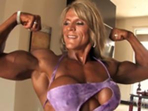 muscle milf flexes her muscles
