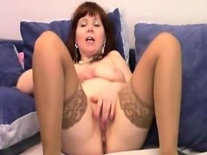 Big tit mature rubbing against her cunt