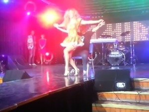 Lucky dude is treated to a hot lap dance onstage from a sex
