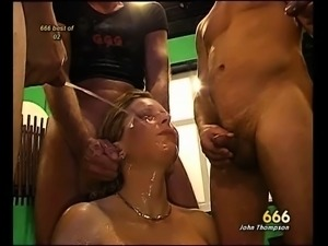 Big breasted tart lets a bunch of horny guys piss all over her naked body