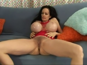 Admirable mature amateur with fake tits giving a steamy tit fuck