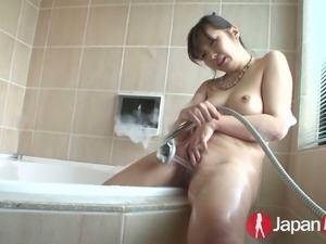 Alluring Japanese hoe Haruka Oosawa takes hot tub and masturbates