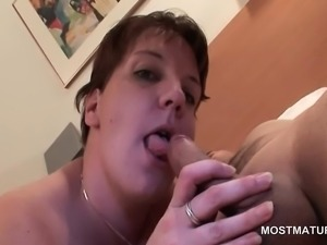 Mature giving BJ gets cum shot on her tits