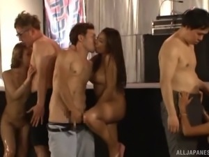 Group of attractive Asian ladies getting banged in a huge orgy