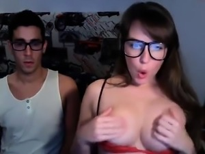 Nerdy school couple having a good time in a chatroom