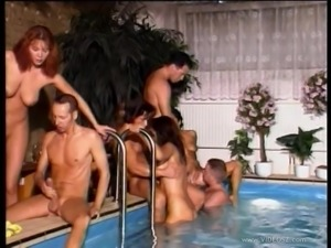 A few busty retro milfs blow and get fucked near a pool