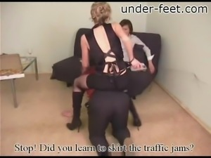 Spineless guy has to lick the feet of his two masters