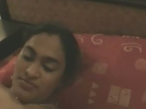 Awesome playful Indian babe with natural breasts filmed in the bedroom