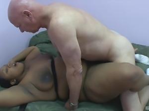 Experienced bald guy penetrates the fat black bimbo's beaver
