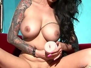 Tattooed brunette beauty Tera Patrick plays with sex toy