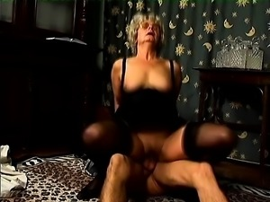 Mature lady in black lingerie has a hard stick plowing her hairy cunt