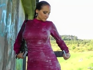 Gina pours water all over her body and rubs herself down outside