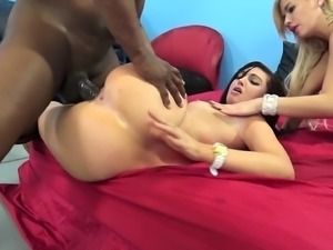 Blonde and brunette lesbians take turns wildly fucking a black stick
